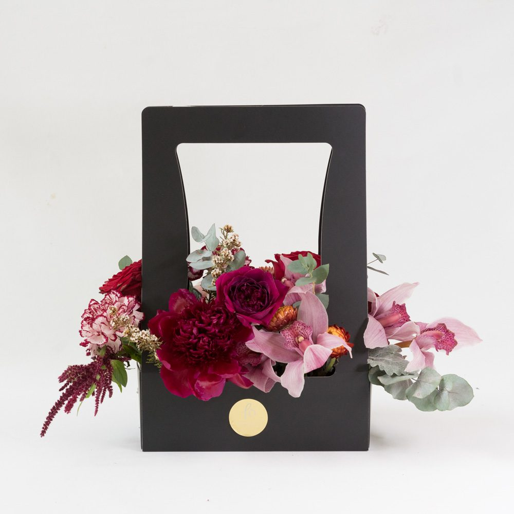 Presented in our new signature carrying boxes is an array of rich, moody blooms in red tones- perfect for birthdays, new love, anniversaries, and the fashionista! 20cmW x 30cmH