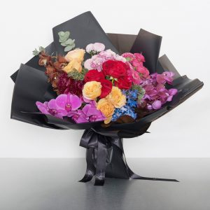 An explosion of bright, cheerful colours in this charming bouquet f mixed blooms; an unforgetable surprise to mark any celebration! Flowers may vary from picture but will consist of bright and colourful blooms fresh from the market. Image shows the large size as a wrapped bouquet 70cmW x 65cmH