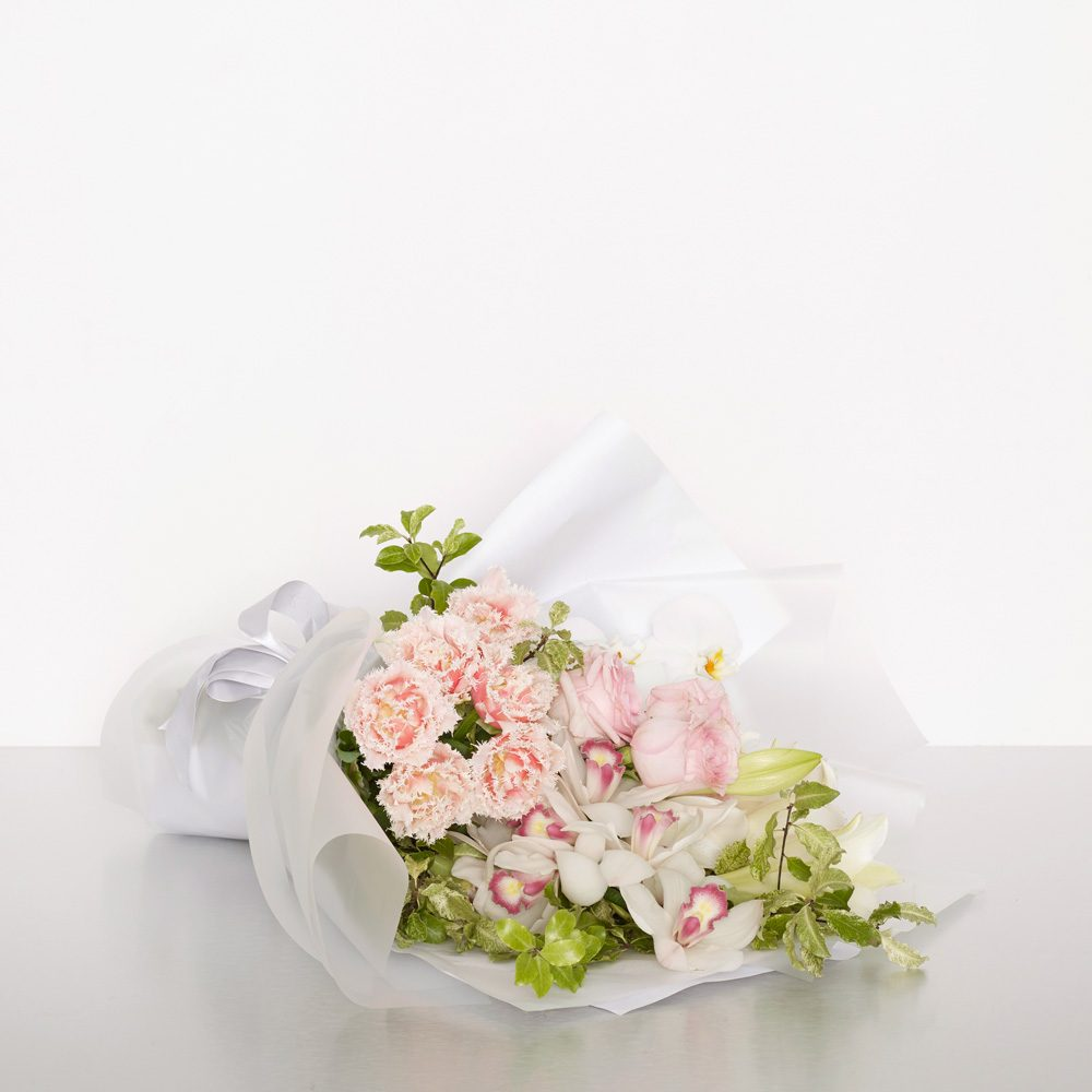 A gorgeous bouquet of grouped roses, lilies, orchids and more. This design is both modern and elegant; popular with flower lovers and gardeners alike. 50cmW x 65cmH