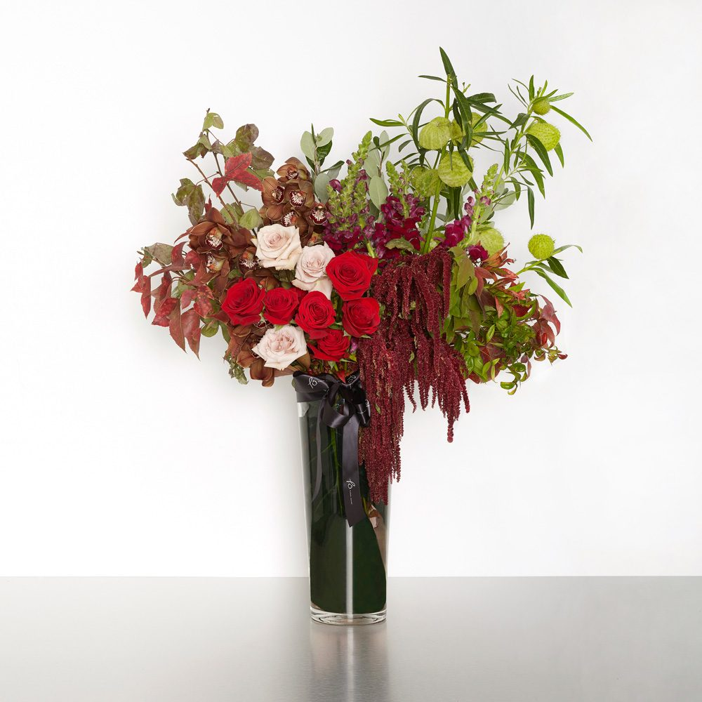 A beautiful array of bold and exquisite flowers, poised to make a grand impression. 50cmW x 70cmL