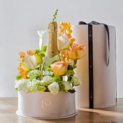 Hidden within our signature cylinder box is a garden of blooms surrounding a bottle of delicious sparkling wine - perfect for celebrations, corporate gifts, and romantic gestures! 20cmW x 35cmH
