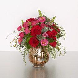 Deep-in-thought red and pink roses, in our copper-accented glass vase, make for a lovely gift for any romantic occasion. 25cmW x 35cmH