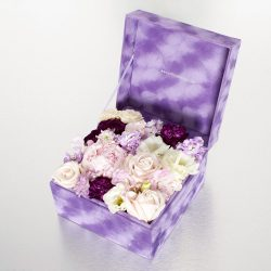 Hidden within our signature velvet box is a selection of opulent pink and purple blooms - a veritable treasure trove of secret delights!   23cm x 23cm