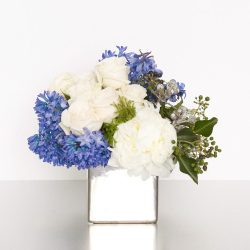 It's always blue skies with this design of pillowy blue and white blooms in a keepsake mirror vase.Perfect for speedy recoveries, new parents, or expressions of sympathy. 28cmw x 25cmH
